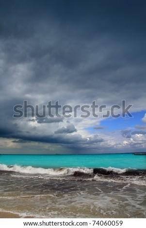 hurricane tropical storm caribbean dramatic cloudy gray sky - stock photo