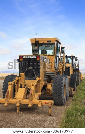 Hurricane, UT, USA - April 15, 2012: Construction equipment parks near highway in preparation for road work.