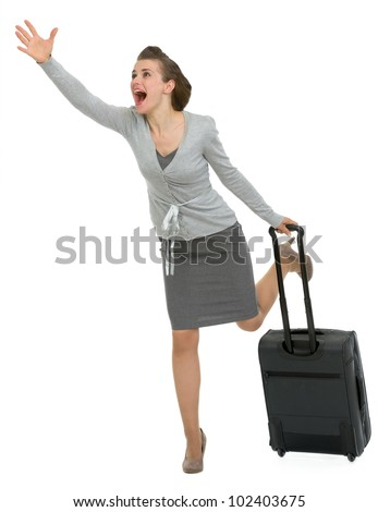 Hurry traveling woman with suitcase - stock photo