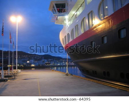 Hurtigruta cruise ship docked in colour. - stock photo