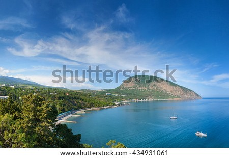 Hurzuf or Gurzuf is a resort-town in the Crimea (northern coast of the Black Sea). The famous mount of Ayu-Dag (Bear Mountain) is in the background - stock photo