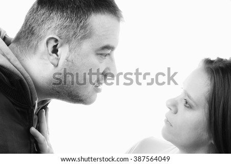 Husband abusing and beating wife during quarrel isolated on white background.