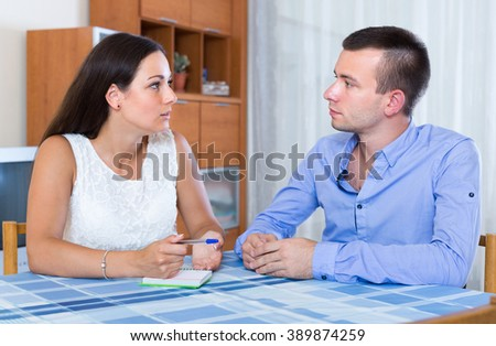 Husband and wife discussing details of separation at home