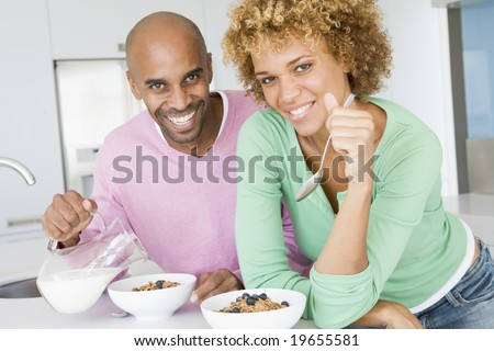 Husband And Wife Eating Breakfast Together