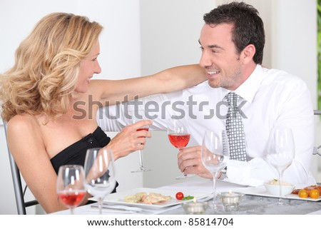 husband and wife enjoying romantic meal - stock photo