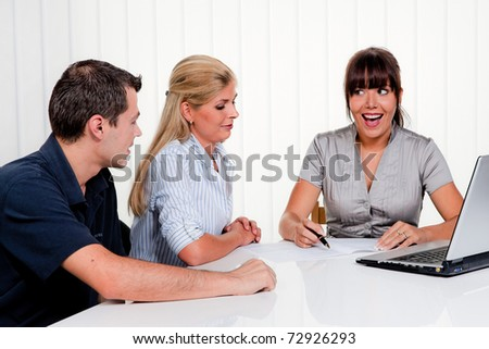 Husband and wife in a consultation in an office - stock photo