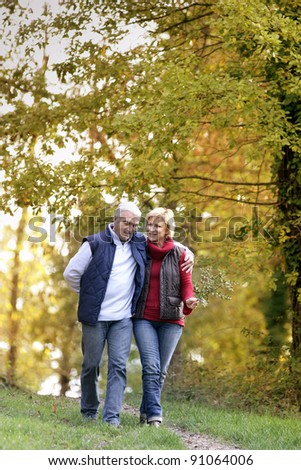Husband and wife in park - stock photo