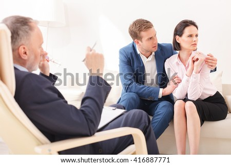 Husband and wife on therapy session - stock photo