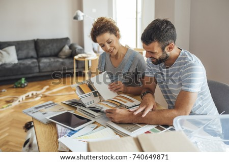 Husband and wife planning interior design.