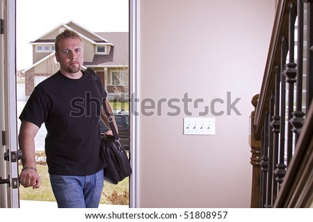 Husband Coming Home from Work Opening the Door - stock photo