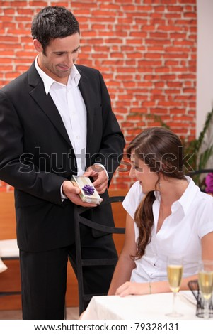 Husband giving wife a present - stock photo