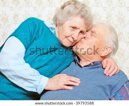 husband kiss wife; portrait senior's - stock photo