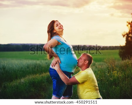 Pregnant Woman Kissing Husband On White Stock Photo ...