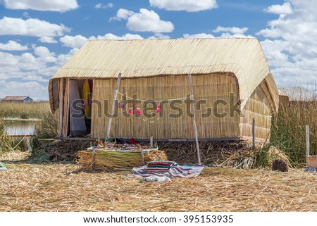 Hut at Uros floating island and village on Lake Titicaca near Puno, Peru - stock photo
