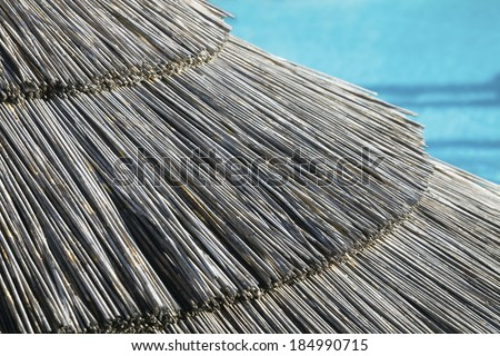 Hut by the pool in the tropical resort - stock photo