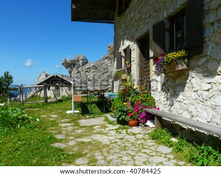 Hut in the mountains - stock photo