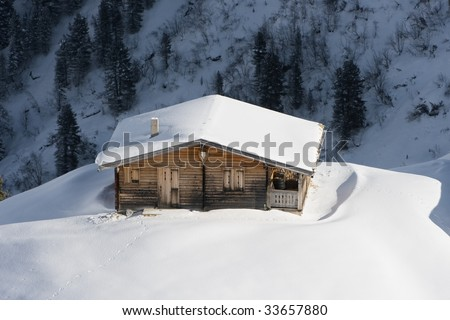Hut in the snow - stock photo
