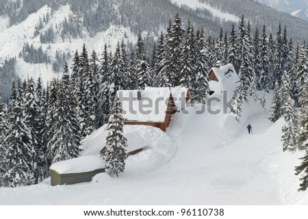 Hut in the snow , Aips - stock photo