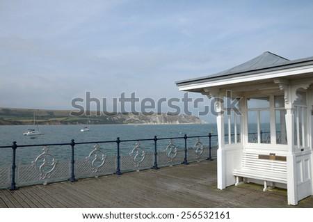 Hut on Pier at Swanage on Dorset coast - stock photo