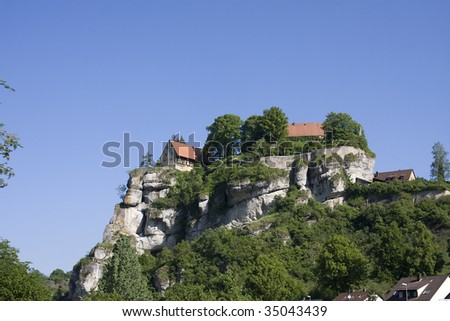 hut on the rocks - stock photo