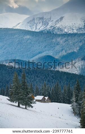 huts in mountain - stock photo
