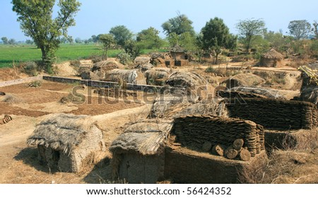 Huts in poor village, near Agra,   India - stock photo