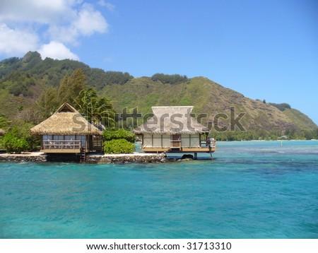 Huts in Tahiti - stock photo