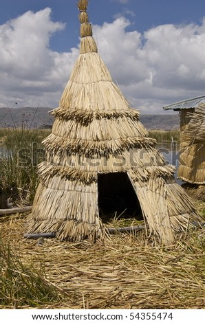 Huts on the floating islands in Lake Titicaca. - stock photo