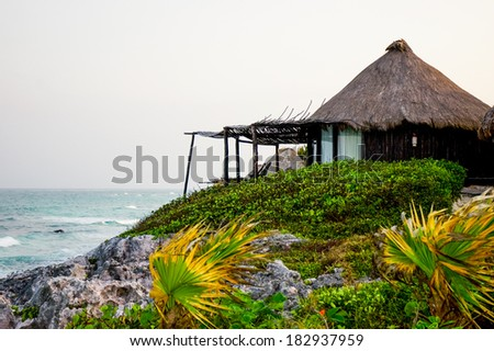 Huts with minimalism in mind on a beach in the Riviera Maya. - stock photo