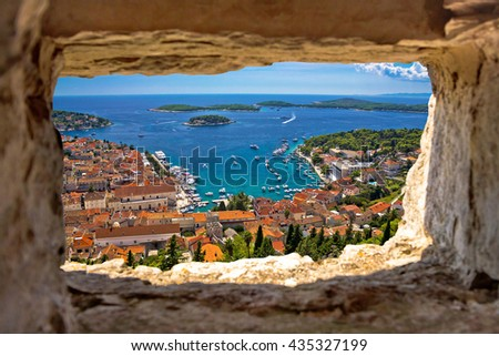 Hvar bay aerial view through stone window from Fortica fortress, Dalmatia, Croatia