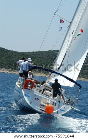 HVAR, CROATIA - MAY 20: Sailing yacht in the Republic Cup international sailing competition on the Adriatic sea on May 20, 2003 in Croatia. - stock photo