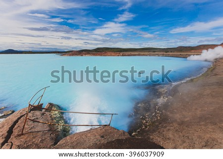 Hverir geothermal area in the north of Iceland near Lake Myvatn, with geothermal lake, looking like Blue Lagoon, Hot Mud Pots and great landscape in the Geothermal Area Hverir, summer day. - stock photo