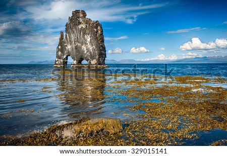 Hvitserkur is a spectacular rock in the sea on the Northern coast of Iceland. Legends say it is a petrified troll.  - stock photo