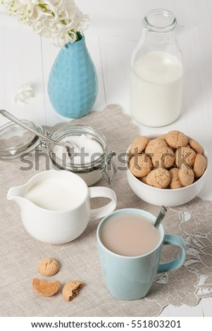 Hyacinth Flowers In Vase. Amaretti Biscuits. Cup Of Tea.