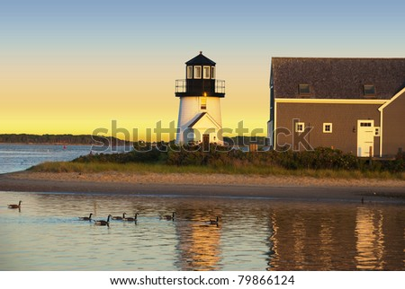 Hyannis harbor lighthouse at sunset - stock photo