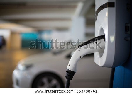 Hybrid car electric charger station in the Car Park. - stock photo