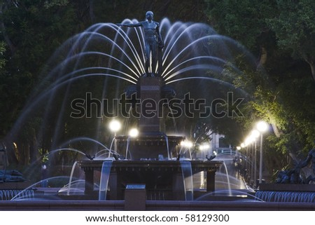 Hyde park Sydney archibald fountain dusk blurred water streams highlighted statue - stock photo