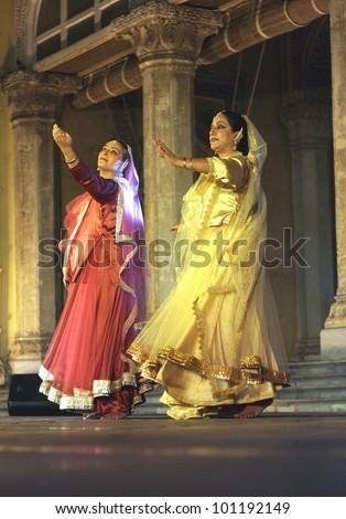 HYDERABAD,AP,INDIA-APRIL 23:Kathak Dancers Mangala bhatt and Deepti Gupta perform during heritage week at chowmohalla palace on April 23,2012 in Hyderabad,Ap,India.classical dance of North India. - stock photo