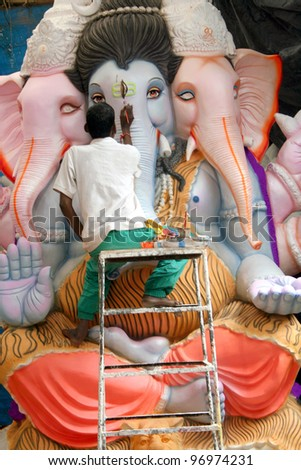 HYDERABAD,AP,INDIA-AUGUST 23:Artist making the Ganesha Idol for Ganesha chathurthi festival August 23,2011 in Hyderabad,Ap,India.Idols are worshipped for 10 days and immersed in tanks,rivers etc.