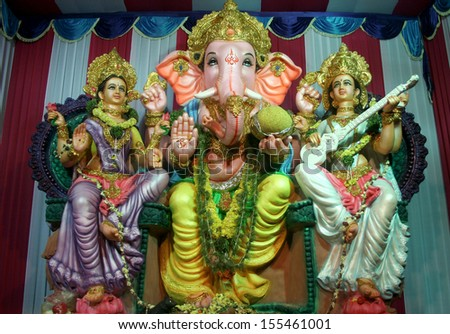 HYDERABAD,AP,INDIA-SEPTEMBER 11:Hindu devotees instal Ganesha Idol in a pandal, during Ganesha chathurthi festival,for prayers on 11 days  on September 11,2013 in Hyderabad,Ap,India.  - stock photo