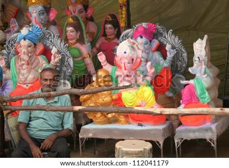 HYDERABAD,AP,INDIA-SEPTEMBER 02:Trader exhibits the Ganesha idols during the Ganesh chathurthi hindu festival on September 02,2012 in Hyderabad,Ap,India.Every year thousands of idols are sold. - stock photo