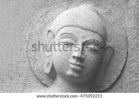 HYDERABAD,INDIA-AUGUST 28:Closeup of Head of Gautama Buddha carved out of stone in shilparamam rock garden on August 28,2016 in Hyderabad,India
