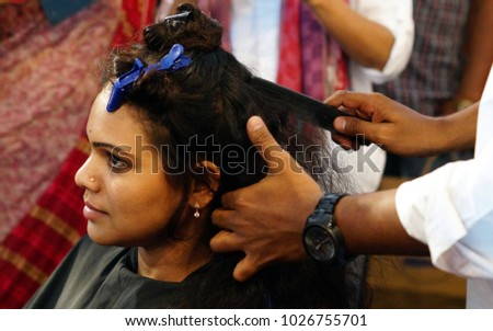HYDERABAD,INDIA-FEBRUARY 6:Hair stylist or Hair dresser does work on Indian Woman in the beauty salon on February 6,2018 in Hyderabad,India