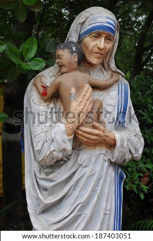 HYDERABAD, INDIA - JULY 27: Mother Teresa statue at Shilparamam in Hyderabad, India, on July 27, 2012. It is an arts and crafts village creating an environment for preservation of traditional crafts. - stock photo