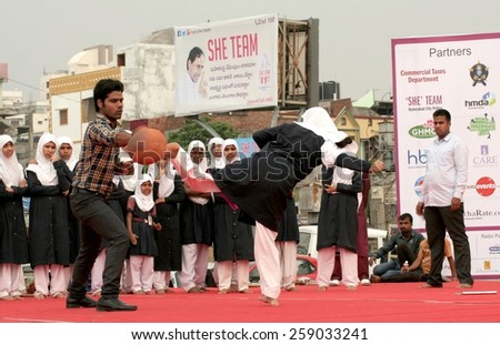 HYDERABAD,INDIA-MARCH 8:college students show self protection methods during  International women's day celebrations at necklace road on March 8,2015 in Hyderabad,India.