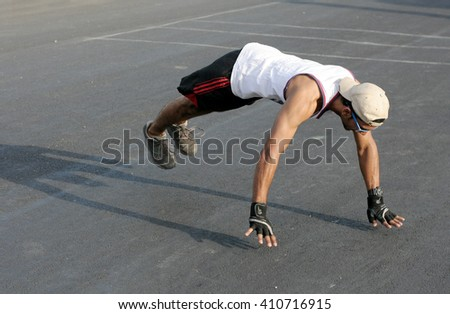 HYDERABAD,INDIA-MARCH 20: Indian man do push ups and jump up from the floor during raahgiri event on March 20,2016 in Hyderabad,India