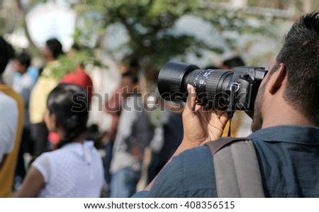 HYDERABAD,INDIA-MARCH 10: Indian photographer shoot the crowd on raahgiri day,open roads program on March 10,2016 in Hyderabad,India.