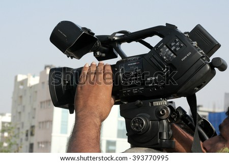 HYDERABAD,INDIA-MARCH 20:Indian videographer use Video camera to shoot an event on March 20,2016 in Hyderabad,India - stock photo