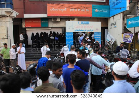 HYDERABAD, INDIA - NOV 11: Unidentified people stand in long queue outside banks to deposit banned 500 and 1000 currency notes on November 11, 2016 in Hyderabad, India.