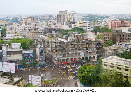 HYDERABAD, INDIA - SEPTEMBER 16, 2008: View on a crossroads and buildings in the center of Hyderabad, India - stock photo